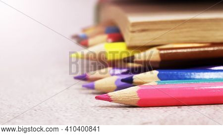 Close Up Of Color Pencils And A Book So Close