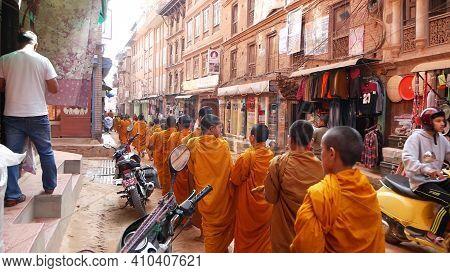 Bhaktapur, Kathmandu, Nepal - 18 October 2018 Young Buddhist Monks Procession Parade Walking For Alm