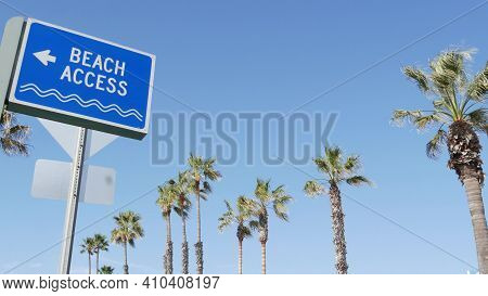 Beach Sign And Palms In Sunny California, Usa. Palm Trees And Seaside Signpost. Oceanside Pacific To
