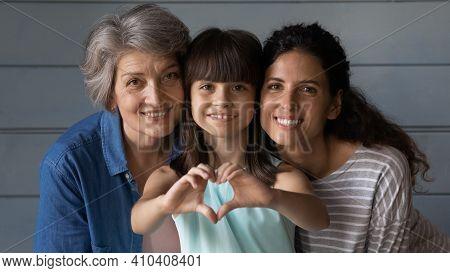 Portrait Of Happy Three Generations Of Latino Women
