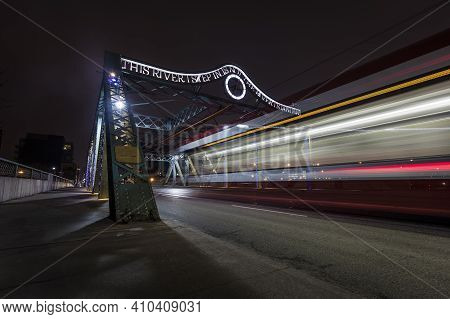 Toronto, Ontario, Canada - March 29 2018: A Toronto Tram Passing Queen Street Bridge