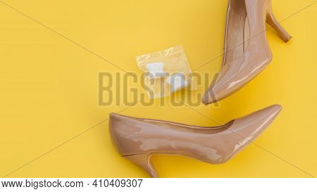 Foot Silicone Toe Separator And Beige Shoes. Valgus On Female Feet. Prevention And Treatment Of Hall