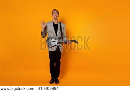 Debut, A Guy With A Guitar On A Yellow Background, Shy And Complex.