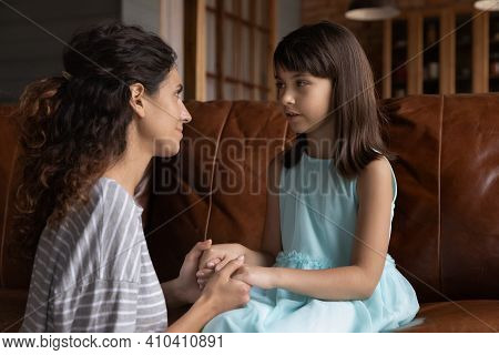 Caring Latino Mom And Daughter Reconcile At Home
