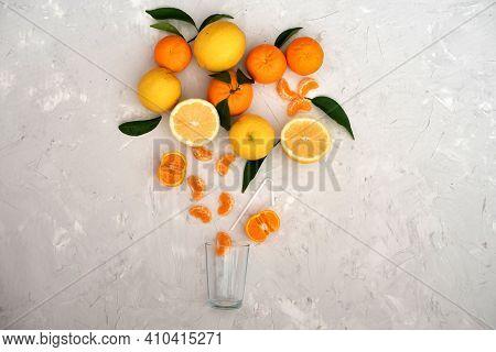 Many Citrus Fruits: Tangerines, Orange, Grapefruits, Mandarin, Lemon  On Gray Background. All Vitami