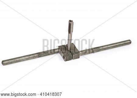 Plug Tap Fixed In Tap Wrench For Manually Cutting Thread In Holes, On A White Background