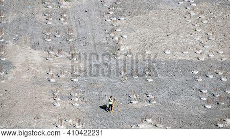 Kiev, Ukraine August 27, 2019: Woman Surveyor Checks The Level Of Installed Piles.