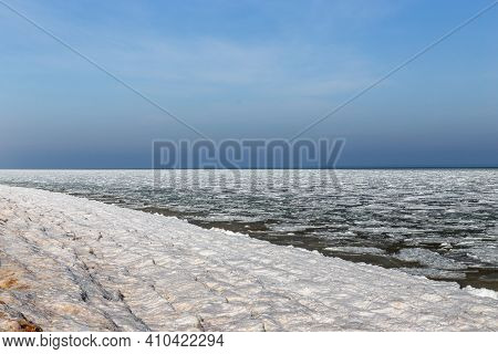 This Is Frozen Coast Of Azov With Ice Floes Near The Coast And An Icy Surf.