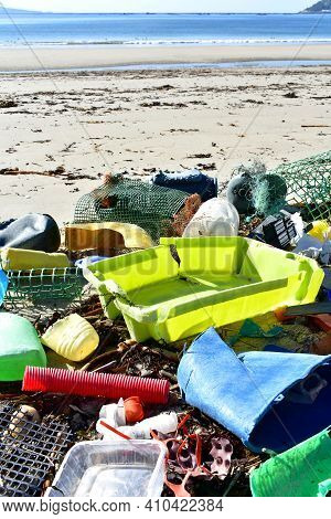 Beach With Plastic Pollution On Sand At Famous Rias Baixas Region. Galicia, Spain.