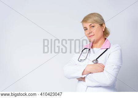 Profile Photo Of Senior Blonde Family Doc, Patients Consultation, Friendly Smiling, Reliable, Clinic
