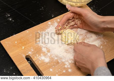 Women's Hands Form, Sculpt Cottage Cheese Pancakes On A Wooden Plank Close-up, Photo From Behind