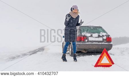 Young Woman Stands By Her Car, Screaming, Angry, And Waiting For Help. Car Breakdown On A Country Ro