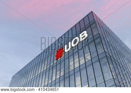 Singapore. February 27, 2021. Editorial Use Only, 3d Cgi. Uob Signage Logo On Top Of Glass Building.
