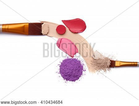 Smears Of Foundation For Face. Pink Red Lipstick Smeared On White Background. Loose Eye Shadow. Cosm