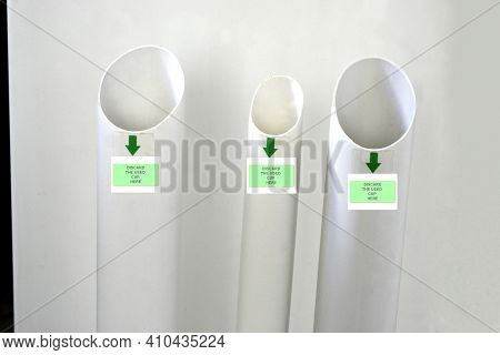Used disposable cup collector, equipment for disposing coffee and water cups made of white PVC, widely used in offices throughout Brazil, South America