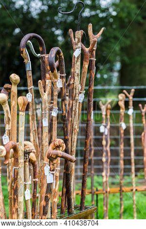 Display Rack Of Rack Of Wooden Walking Sticks.