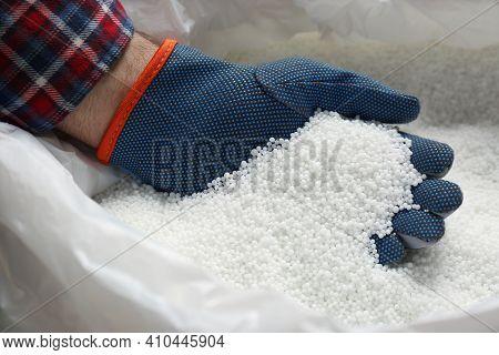 Farmer Taking Pellets Of Ammonium Nitrate From Bag, Closeup. Mineral Fertilizer
