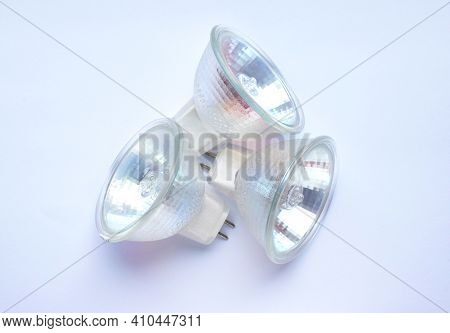 Three Low Voltage Halogen Lamps For Ceiling Lamps Lamps On A White Background.