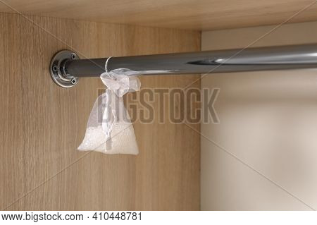 Scented Sachet Hanging On Metal Bar In Wardrobe