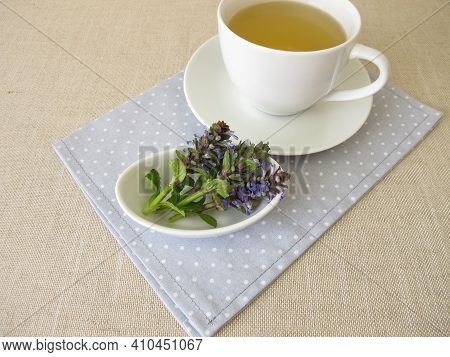 A Cup Of Herbal Tea With Bugle