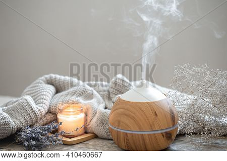 Aroma Composition With A Modern Aroma Oil Diffuser On A Wooden Surface With A Knitted Element, Candl