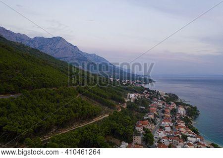 Famous Adriatic Coast. Aerial Evening View Of Picturesque Coastline In Makarska Riviera, Brela, Croa