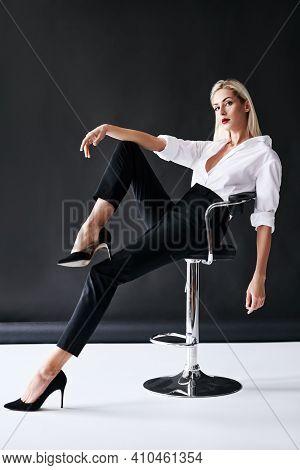 Full Length Portrait Of Daring Trendy Woman Posing On Black Studio Background. Gorgeous Stylish Blon