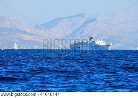 Split, Croatia - January 1, 2000: View Of A Ship With Mountains Above Split In The Background