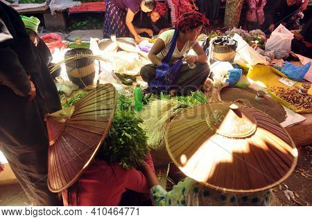 Inle, Myanmar - November 29, 2015: Green Local Lake Market In Sunlight, Ethnic Poor Asian Tribe Peop