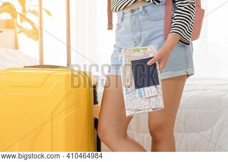 Cloceup Fo Hand Woman Holding Paper Map, Passports And Boarding Pass In Her Bedroom. It Is A Time To