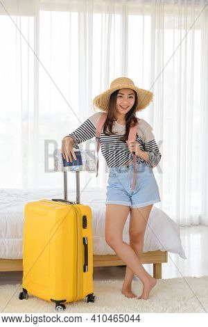 Portrait Of Young Asian Woman In Summer Casual Clothes And Hat Is Smilling And Relaxing Mood With He