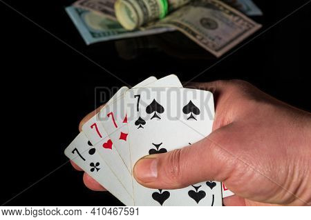 Poker Cards With Four Of A Kind Or Quads Combination. Close Up Of Gambler Hand Is Holding Playing Ca