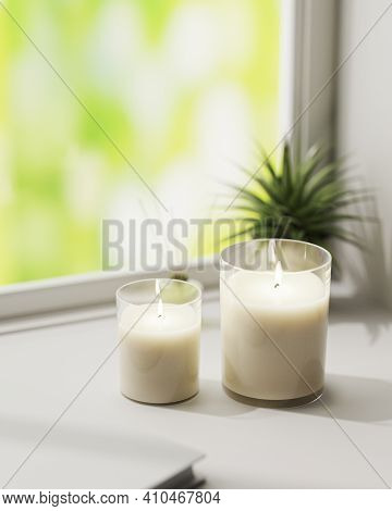 Scented Candle, Burning White Aromatic Candles In Glass On White Surface With Green Plant On Backgro