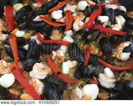 A Seafood Paella Is Cooked In A Paella Pan On A Suburban Grill, Will County, Illinois