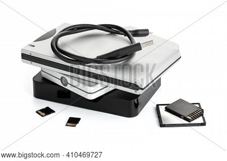 Group Of External Hard Disks And Memory Cards Isolated On White Background. Data Storage Concept