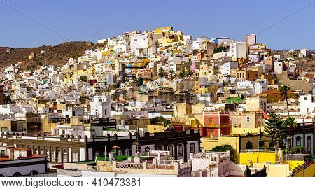 Aerial View Of The City Of Las Palmas With Its Multi-colored Houses On The Side Of The Hills That Su
