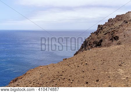 Elevated View Of Sea From A Cliff. Far Horizon Between The Sea And The Blue Sky. Gran Canaria.