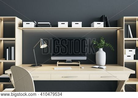 Blank Black Computer Monitor Screen With Lamp And Vase On Wooden Desk Table In Eco Style Interior Ro
