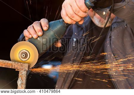 Man Working With Grinder Saw, Close Up View On Tool. Electric Saw And Hands Of Worker With Sparks. W