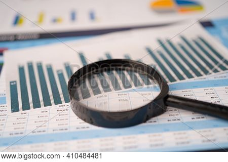 Magnifying Glass On Spreadsheet Charts Graphs Paper. Financial Development, Banking Account, Statist