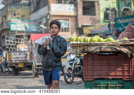 Jaipur, India. 09-05-2018. Young Boy Walking On The Streets Of Jaipur In The Rajasthan While Buying