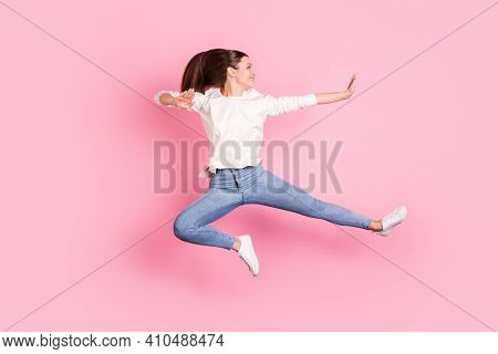 Photo Of Funny Sporty Young Woman Wear White Clothes Jumping Practicing Karate Isolated Pink Color B