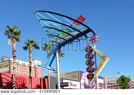 LAS VEGAS - DEC 7, 2017: The giant neon Martini Glass and Vegas signs that hang above Freemont Street in downtown Las Vegas.