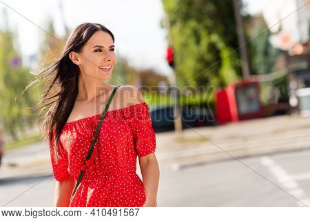 Photo Of Charming Dreamy Nice Young Woman Look Urban Life Wear Print Red Blouse Outside In City Outd