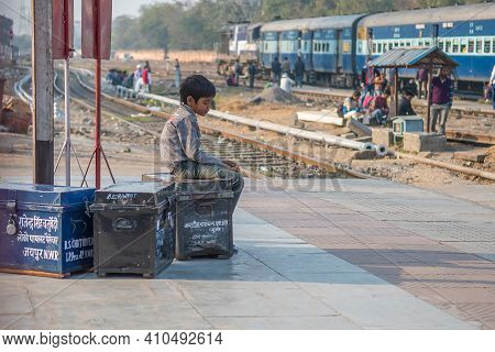 Jaipur, India. 09-05-2018. A Lonely Boy Is Sitting With His Belonging At The Main Train Station In J