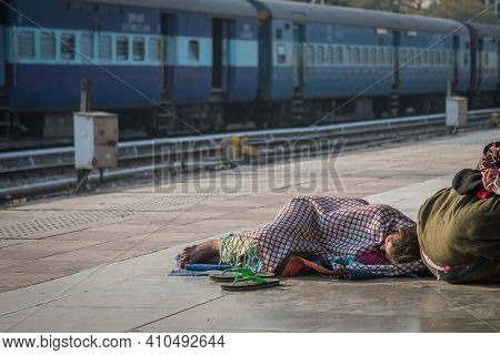 Jaipur, India. 09-05-2018. A Woman Is Sleeping On The Floor At The Main Train Station In Jaipur.