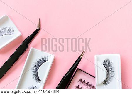 Tools For Eyelash Extension On Trendy Pastel Pink Background. False Eyelashes And Tweezers. Beauty S