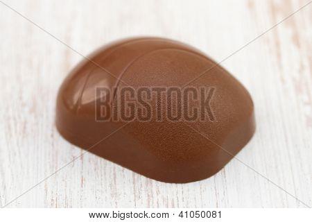 Chocolate  Bonbon On White Old Table