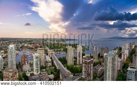Aerial Panoramic View Of A Beautiful Modern City On The Pacific West Coast. Colorful Sunrise Sky Art