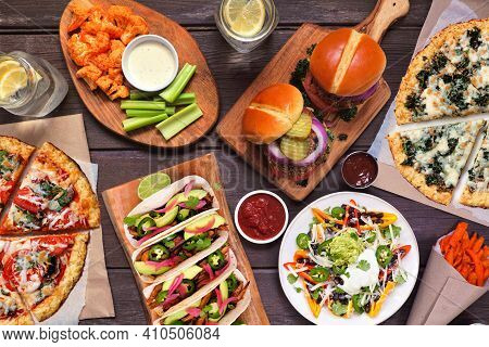 Healthy Plant Based Fast Food Table Scene. Overhead View On A Wood Background. Cauliflower Crust Piz